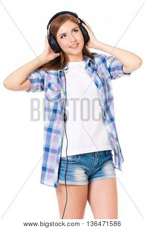 Teen student girl with headphones listening music, isolated over white background