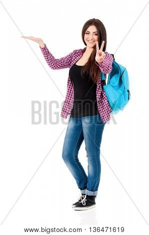 Happy teenage student girl holding her hand showing on open palm with empty copy space, isolated over white background