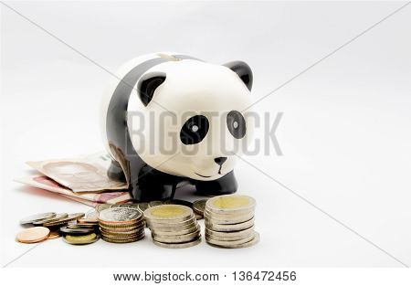 Piggy bank like shape panda and it has a money