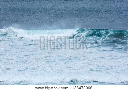 Blue sea wave background. View from beach.