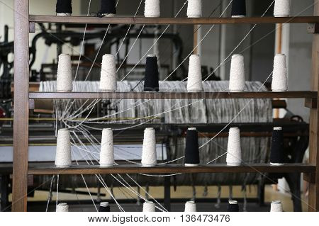 Spools Of Thread To Spin In The Old Industrial Weaving Loom Fabr