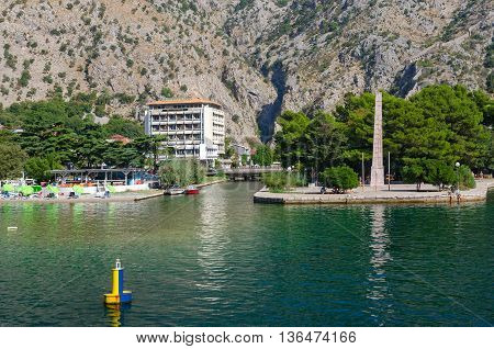 KOTOR MONTENEGRO - SEPTEMBER 16 2015: Obelisk of Freedom in Freedom Park on waterfront in Kotor Montenegro