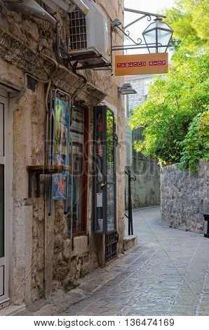 BUDVA MONTENEGRO - SEPTEMBER 17 2015: Tobacco shop on street of Old Town in early morning Budva Montenegro