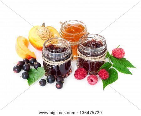 Jam In Glass Jars Isolated On White Background.