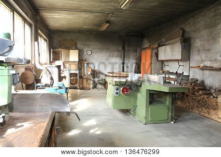 Disused Carpentry With The Machine To Cut The Wooden Planks