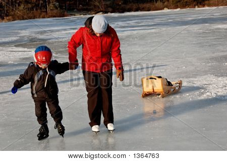 Child Being Helped On Ice Skates