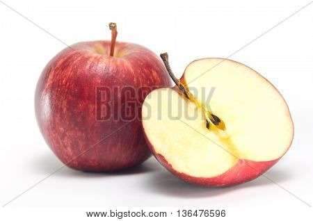 Apple and a half close-up view isolated on white background (Other names are Malus domestica golden apple crab apple red apple)