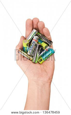 Group of batteries in hand, isolated on white background