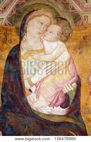 FLORENCE, ITALY - JUNE 05: Virgin Mary with baby Jesus, fresco on the house facade in Florence, Italy, on June 05, 2015
