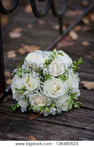 bouquet of white roses on an old tree