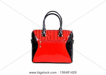 red and black color lacquer handbag isolated on white background