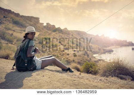 Fashionable girl hiking