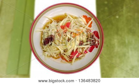 Papaya Salad and crab salty blur background green color.