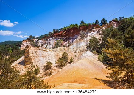 Reserve in mining ocher quarry. Orange and red picturesque hills. Languedoc - Roussillon, Provence, France