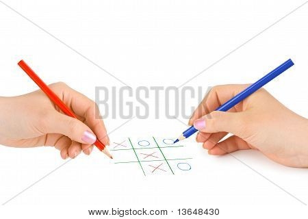 Hands with pencils and game