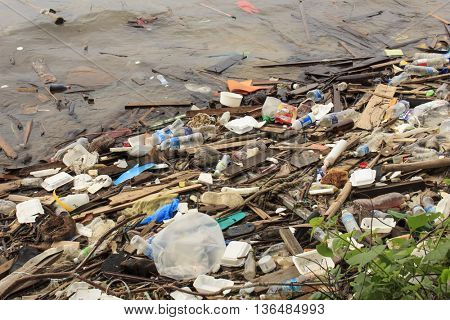 SANDAKAN, MALAYSIA - CIRCA JUNE 2016: Pollution environmental problem. Water pollution due to plastic bags and bottles and pther rubbish thrown directly into the sea and washing up on beach.