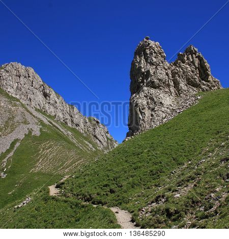 Rocks beside a mountain pass in the Alpstein Range. Hiking route in the Swiss Alps.