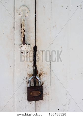 Master key lock white old wood door