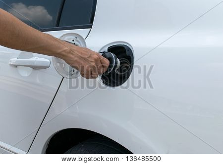 Hand opening the oil filler cap. cap, car, gas, service,