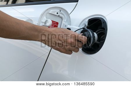 Hand opening the oil filler cap. engine, pump, diesel