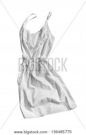 White linen sundress folded on white background