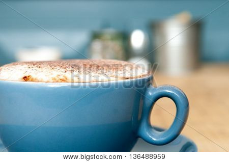 Close Up Of A Fresh Coffee In A Blue Cup
