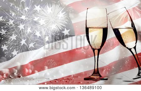 Celebrating Independence Day with champagne. United States of America USA flag with fireworks background for 4th of July