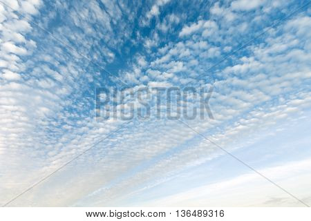 Blue sky with cumulus white clouds background.