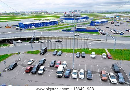 ST PETERSBURG RUSSIA - MAY 11 2016. Birds eye view of airport auto crowded parking lot in Pulkovo International airport in Saint-Petersburg Russia.Parking. Parking lot. Parking at the airport.