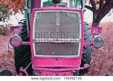 old pink tractor . vintage . retro.