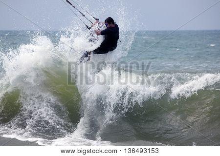 Kiteboarder enjoy surfing in ocean. MuiNe, Vietnam