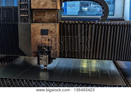 Interior of workshop in a plant that manufactures agricultural equipment with laser welding robot