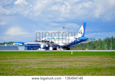 SAINT PETERSBURG RUSSIA - MAY 11 2016. VQ-BTY Ural Airlines Airbus A319 airplane after landing in Pulkovo airport.