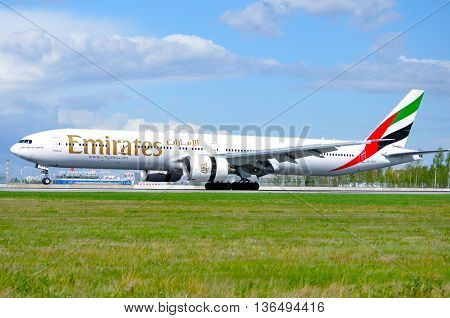 SAINT PETERSBURGRUSSIA-MAY 11 2016.A6-EBY Emirates Airline Boeing 777 airplane rides on the runway after landing in Pulkovo airport.