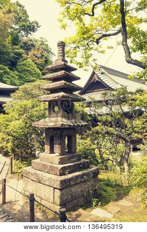 ancient stone lantern structure in Japanese temple garden
