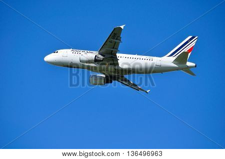 ST PETERSBURG RUSSIA -MAY 11 2016. F-GRHK Air France Airbus A319 airplane is flying in the sky after departure from Pulkovo airport.