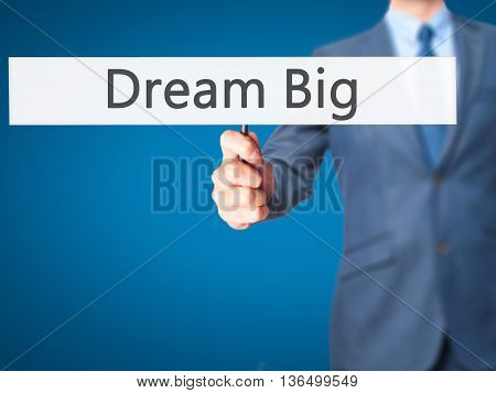 Dream Big - Businessman Hand Holding Sign