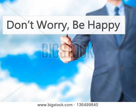 Don't Worry, Be Happy - Businessman Hand Holding Sign