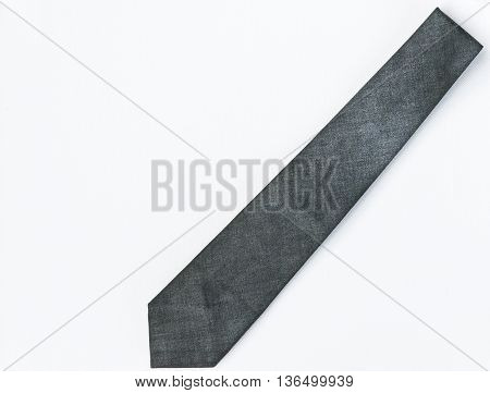 Dirty gray necktie on the white background for business man.