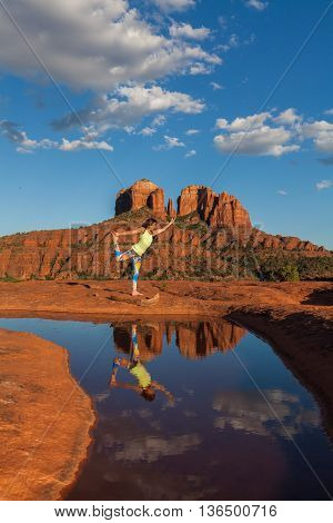 woman practicing yoga at cathedral rock near sedona arizona