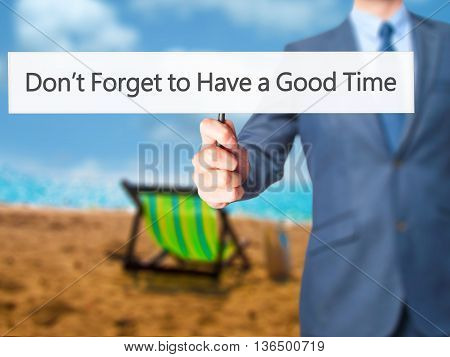 Don't Forget To Have A Good Time - Businessman Hand Holding Sign