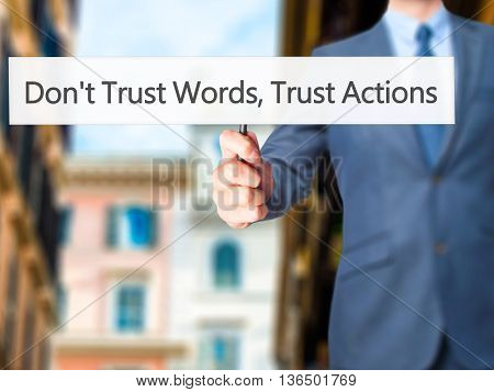 Don't Trust Words, Trust Actions - Businessman Hand Holding Sign