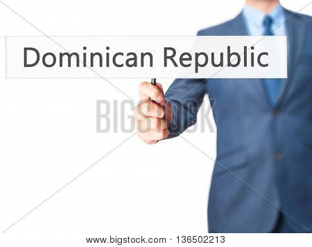 Dominican Republic - Businessman Hand Holding Sign