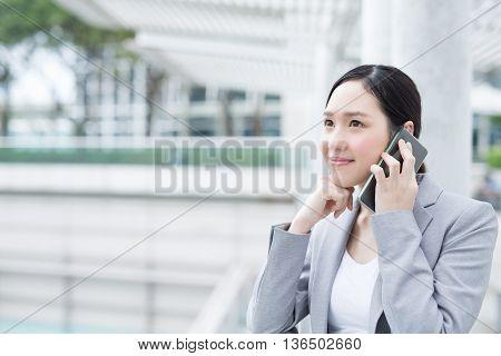 business woman smile speak smart phone in office asian beauty