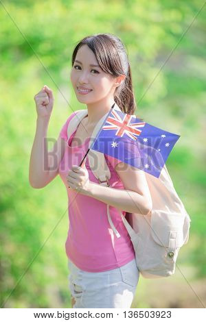 Happy College Student girl hold australian flag and show fist with nature white background asian