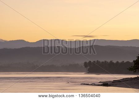 Beach Coast Landscape With Trees And Hills