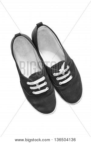Pair of black textile gumshoes isolated over white