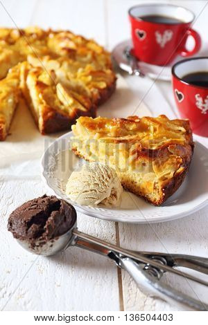 Apple pie ice cream ball and two cups of coffee