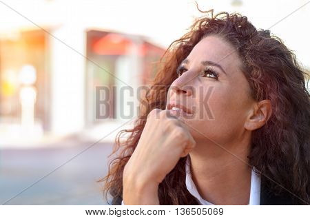 Thoughtful Gorgeous Young Woman Sitting Dreaming