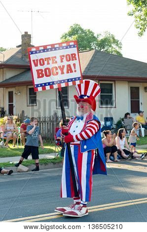 SOUTH ST. PAUL, MINNESOTA - JUNE 24, 2016: Clown entertains crowd holding sign